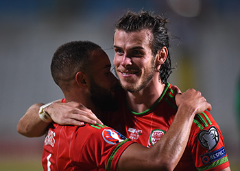 Wales Gareth Bale (right) and Ashley Richards celebrate after the UEFA European Championship Qualifying match at the GSP Stadium, Cyprus. Picture date: Thursday September 3, 2015. See PA story SOCCER Cyprus. Photo credit should read: Andrew Matthews/PA Wire